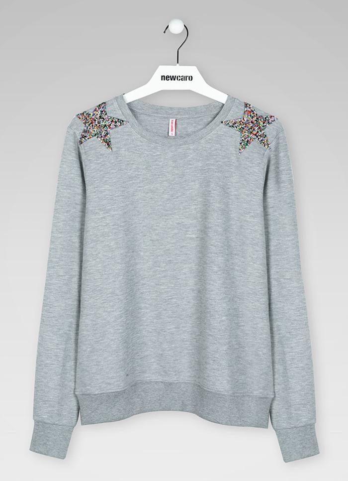 Camiseta de mujer textil en percha